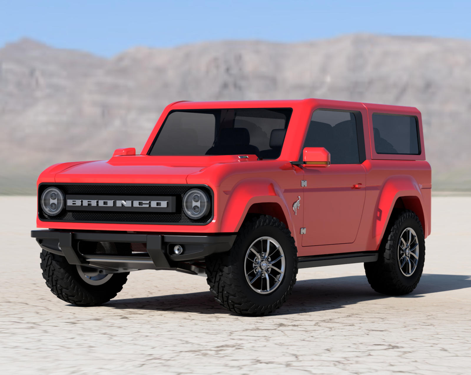 Alone in the desert, stands a shiny red 2021 Ford Bronco